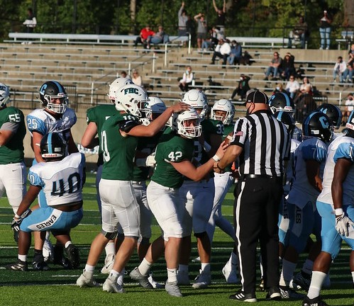 Varsity football opens season with first win over Grand Rapids Christian since 1995
