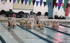 Girls swim and dive easily takes the win over Grand Rapids Christian 112-74
