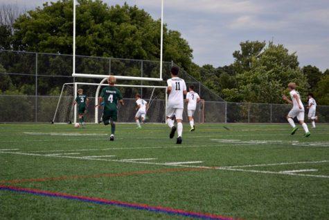 Noah Gleason leads the boys varsity soccer team with a early goal against West Catholic in a 2-0 win