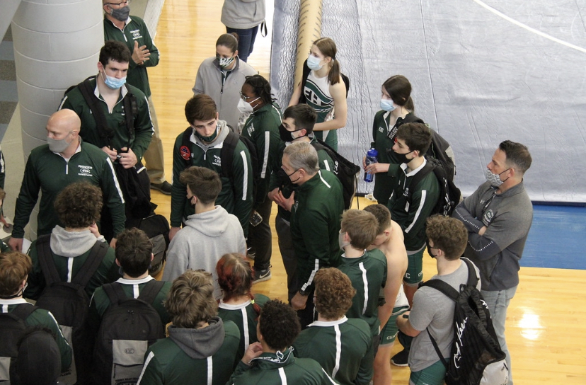 Boys varsity wrestling falls in opening round of team districts