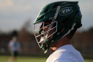 Rowan Clay's move to attack changes the game for boys varsity lacrosse in 18-2 win over Okemos