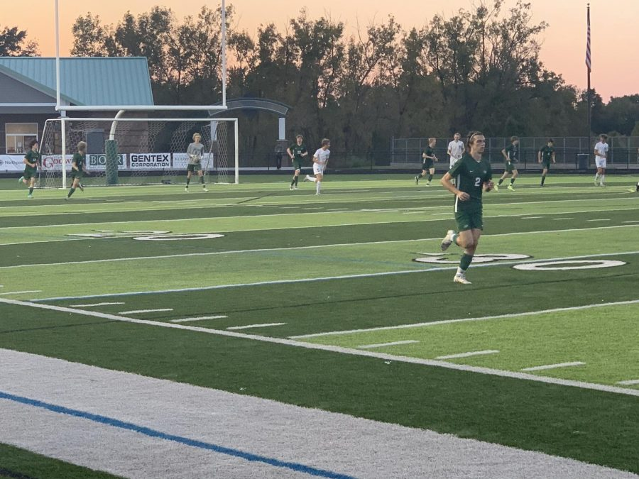 Junior Kyle Webbs dribbling ability in the first half cant save the boys varsity soccer team from a 6-3 loss against top-ranked South Christian