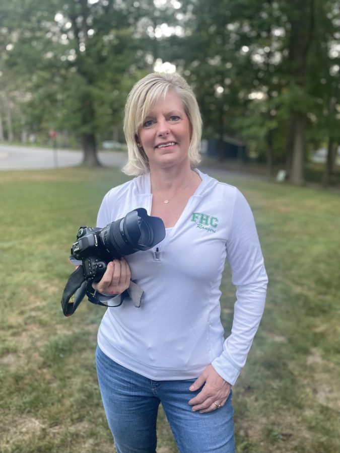 Becki Szczepanek poses for a picture with her trusty Canon 80D.
