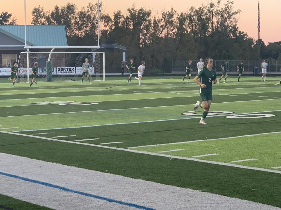 Kyle Webb scores both goals for the boys varsity soccer team in its 2-1 district semifinal win over Lowell