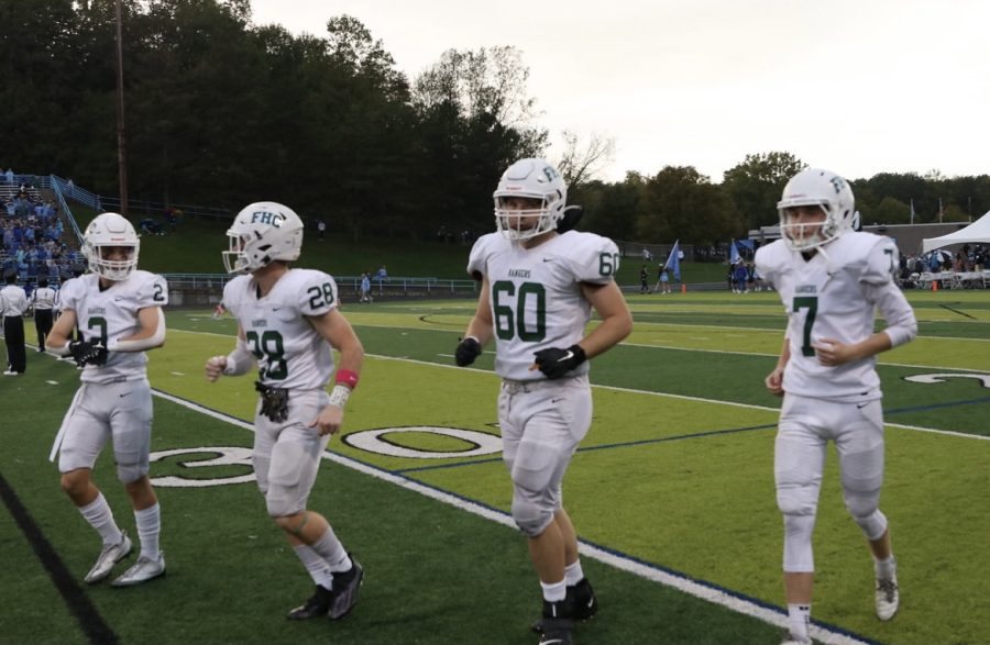 Varsity football team overcomes slow start in the first quarter to defeat rival Forest Hills Northern 35-7