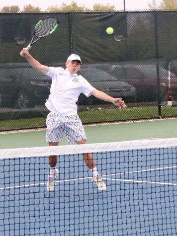 Walker Sjolin punishes the net. Photo by Kyler Pell.